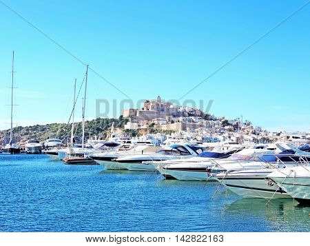 Yacht harbor and view to the fortification of Ibiza town, Dalt Vila.