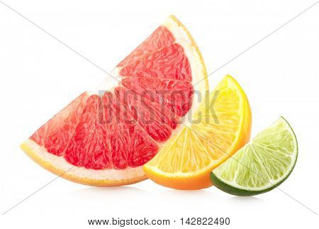 Colorful cirtus slices isolated on white background