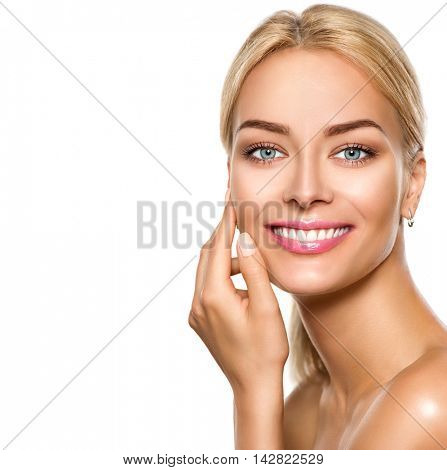 Beauty spa model girl touching face and smiling. Pretty Woman Portrait. Beautiful Perfect Fresh Skin. Pure Beauty Female looking at camera. Youth and Skin Care Concept. Isolated on white background