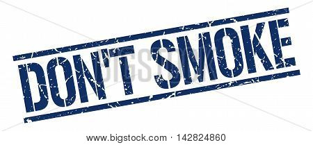 don't smoke stamp. blue grunge square isolated sign
