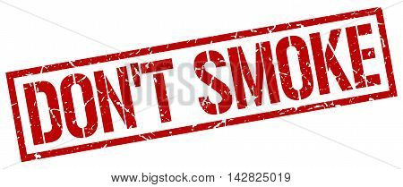 don't smoke stamp. red grunge square isolated sign