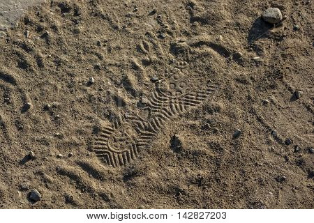 Imprint, footprint of shoe or boot on sand