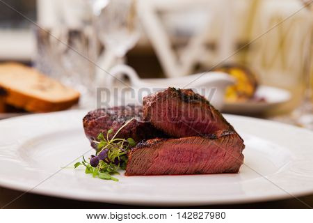 Filet mignon served on a plate in restaurant
