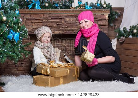 Woman And Girl In Winter Hats And Scarfs