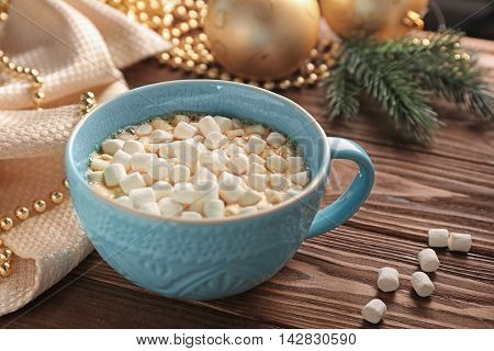 Cup of hot chocolate with marshmallows on table