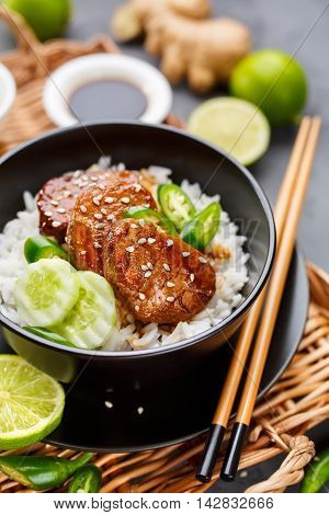 Asian food - meat with rice and vegetables. Food background