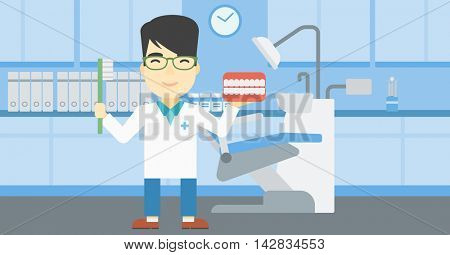 An asian young male dentist holding dental jaw model and a toothbrush in doctor office. Male dentist showing dental jaw model and toothbrush. Vector flat design illustration. Horizontal layout.