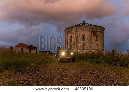 Leningrad region, Russia , August 14, 2016 , Jeep Wrangler night on a deserted road in the Leningrad region, the Jeep Wrangler is a compact four wheel drive off road and sport utility vehicle