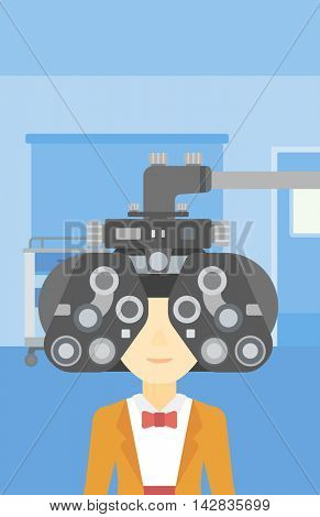 An asian woman undergoing an eye examination while visiting optometrist at the medical office. Vector flat design illustration. Vertical layout.