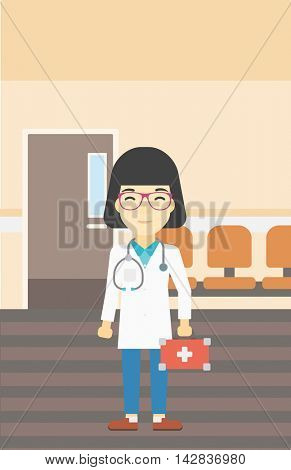 An asian female doctor holding first aid box. Doctor in uniform with first aid kit standing in the hospital corridor. Vector flat design illustration. Vertical layout.