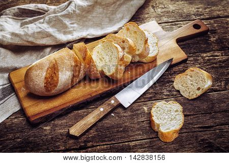 The baguette slices on a cutting board. Food background