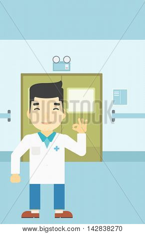 An asian doctor in medical gown showing ok sign in the hospital corridor. Vector flat design illustration. Vertical layout.