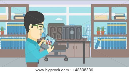 An asian man looking at house on a digital tablet screen. Young man standing in office and looking for house on tablet computer. Vector flat design illustration. Horizontal layout.