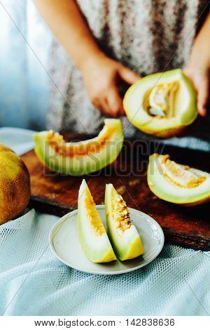 Melon On The Table. Cantaloupe Salad. Delicious Fruits On Dark B