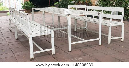 iron Table in the park. Painted white.