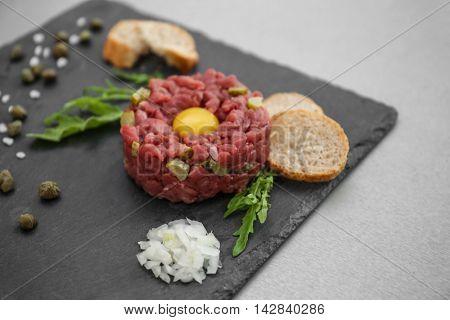 Tasty beef tartare on slateplate