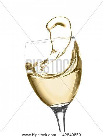 Glass of white splashing wine isolated on white