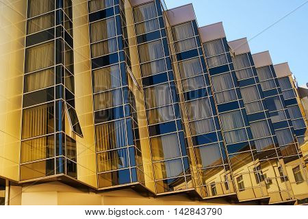 Example of modern architecture apartment building detail with sharp vertical geometrical lines