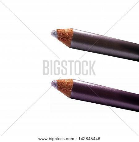 Part Of Metallic Cream Eyeshadow Pencils Pink Isolated On White. Two-tone.