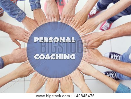 Personal coaching concept. United hands, top view