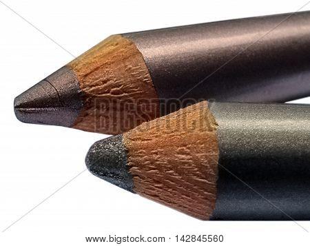 Part Of Metallic Cream Eyeshadow Pencils Gray Purple Closeup Isolated On White. Two-tone.