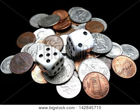 Dice on coins on black. Gambling concept