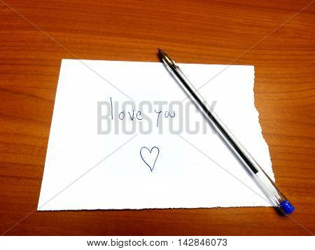 Torn Paper Note Love You And Heart On Wood With Ballpoint Pen