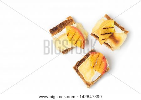 canapes appetizer with grilled brie and nectarine plated Isolated on white