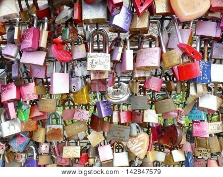 Cologne Germany September 12 2015: Thousands of love locks placed by lovers to the Hohenzollern Bridge Hohenzollernbrücke close up