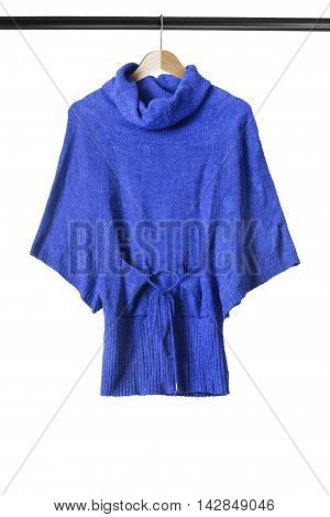 Blue wool sweater on wooden clothes rack isolated over white