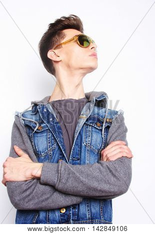 Fashion young man with fashionable sunglasses on white background