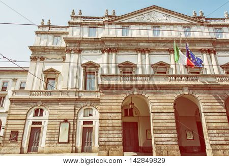 La Scala is an opera house in Milan Italy. Cultural heritage. Yellow photo filter. Travel destination. Architectural scene.