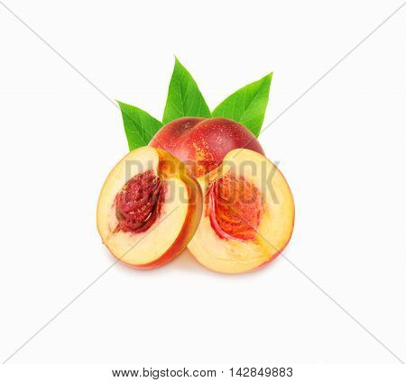 Peaches (nectarine) isolated on white. Peaches with leaves.