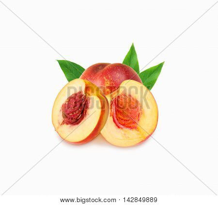 Peaches (nectarine) isolated on white. Peach with leaves.