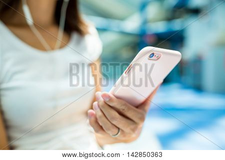 Woman listen to music by mobile phone