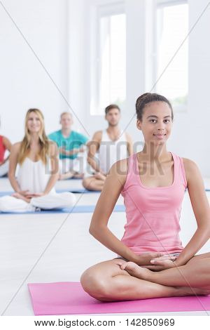 Shot of a young yoga instructor during a pilates session