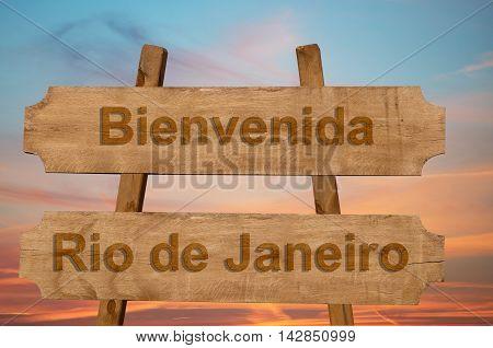 Bienvenida (welcome To In Spanish)  Rio De Janeiro In Brazil Sign On Wood Background