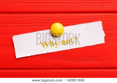 Sheet of paper on red wooden background, why not