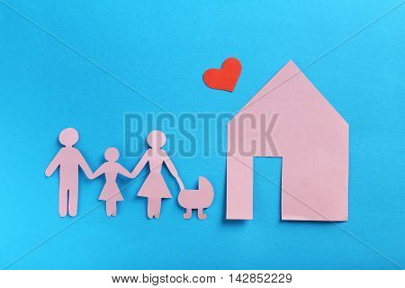 Happy paper family on a blue background