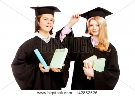 Portrait of two happy graduating students. Isolated over white background.