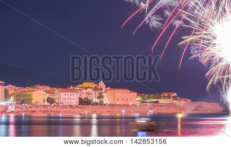 The Ajaccio bay at night during firework for celebration the Assumption and date of birth of Napoleon the 1st French Emperor who was born in Ajaccio Corsica island.