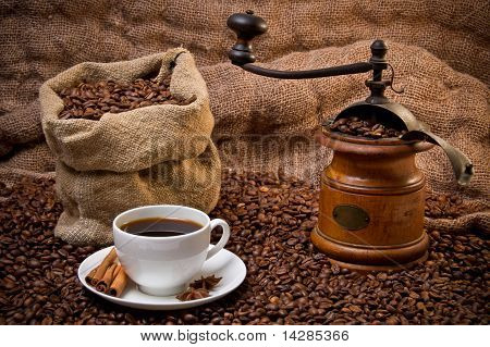 Sack Of Coffee Beans, White Cup And Coffee-grinder Still Life