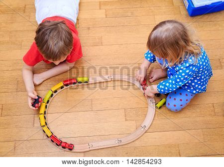 kids playing with railroad and trains indoor, education and daycare