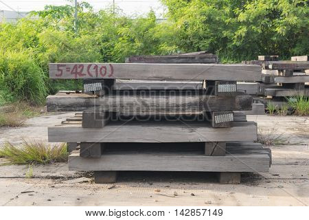 Many old wooden railway sleepers for background