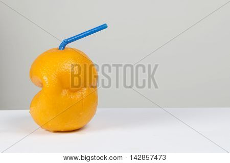 Freshly squeezed orange juice on a white surface - drink concept