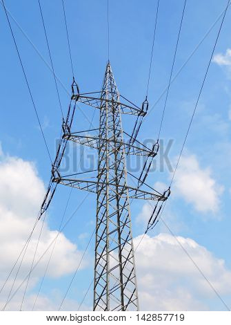 Electric station or hydro tower with blue sky and fluffy clouds.
