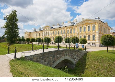 PILSRUNDALE, LATVIA - JULY 27, 2015: Unidentified people visit the Rundale palace facade in Pilsrundale, Latvia.