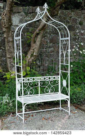Single metal bench in the garden. Nice decoration furniture for garden