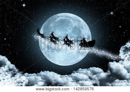 Santa Claus on sleigh by reindeer crossing moon in the night sky. Suitable for Christmas background, Christmas backdrop,Christmas wall paper and everything about Christmas background for your design.