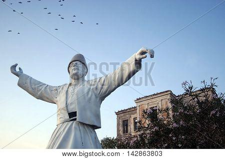 Mevlevi statue in Cunda island, Ayvalik, Turkey